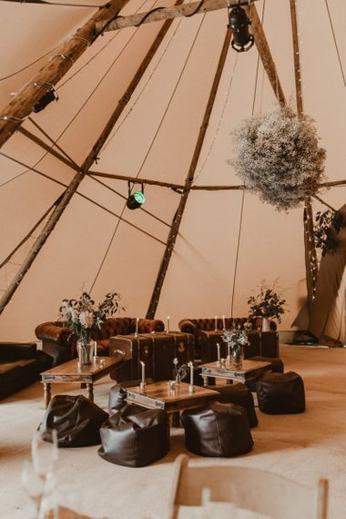 Teepee for wedding reception with seating area