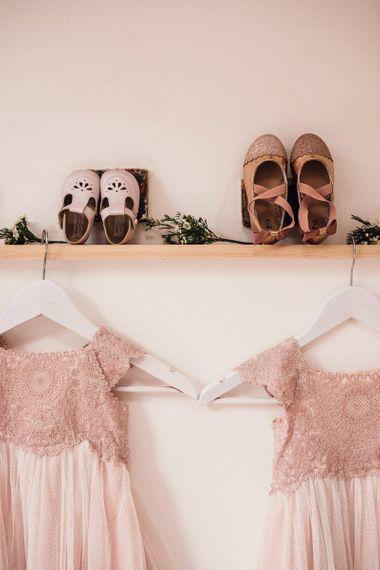 Pink Monsoon Flower Girl Dresses Hanging Up