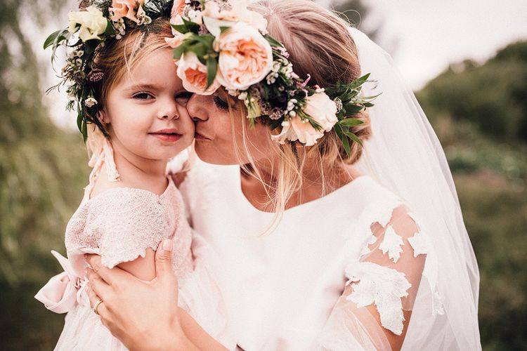 Bride with Peach Flower Crown Kissing a Little Flower Girl