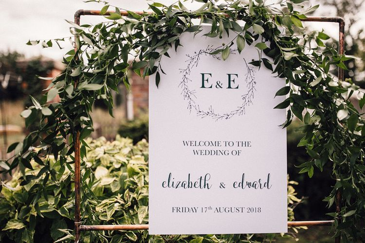 Copper Frame with Wedding Welcome Sign and Greenery Attached