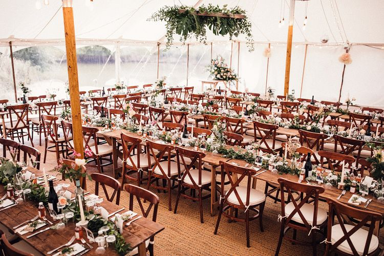 Rustic Marquee Reception Wedding Decor with Greenery and Peach Flower Arrangements