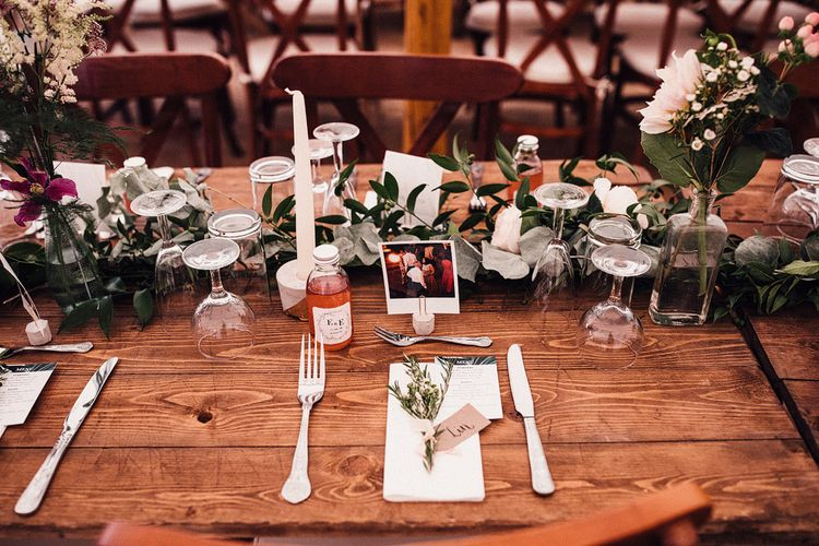 Wedding Reception Table Decor with Polaroid Place Setting and Greenery Table Runner