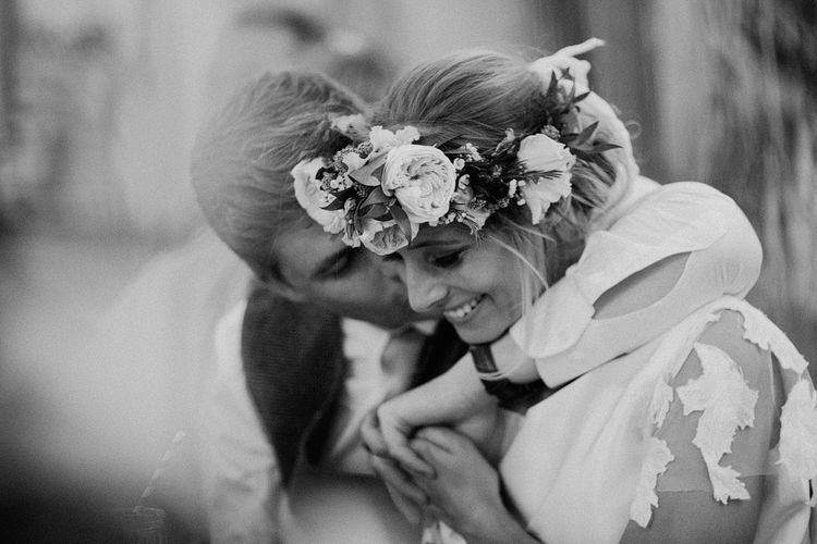 Black and White Portrait of Groom Kissing His Beautiful Bride wearing a Flower Crown
