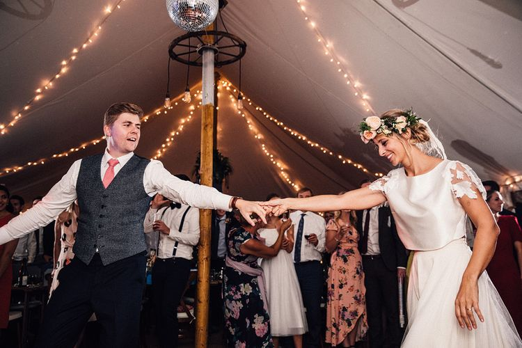 First Dance with Bride in Noble and Wight Separates with Flower Crown and Groom in a  Three Piece Navy Suit