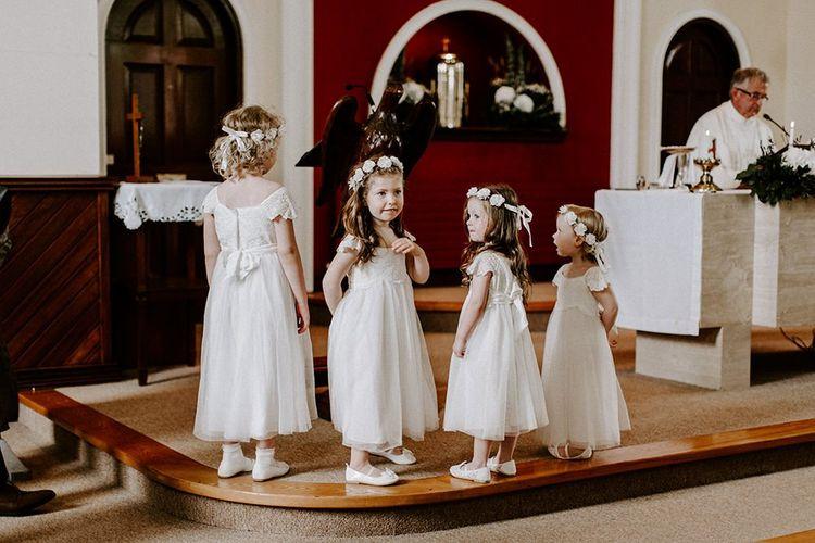 Flower girls in white dresses for wedding in Ireland