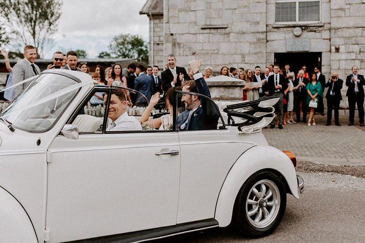 White wedding car for rustic Summer wedding