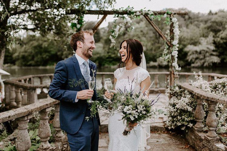 Bride in Jesus Peiro wedding dress with groom in blue wedding suit