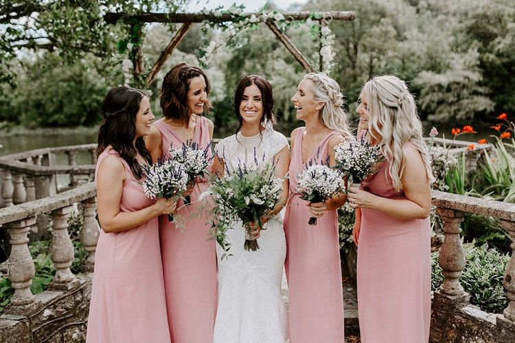 Bride in Jesus Peiro wedding dress with bridal party in pink bridesmaid dresses
