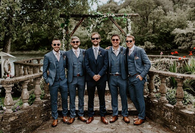 Groom with groomsmen in matching blue wedding suits