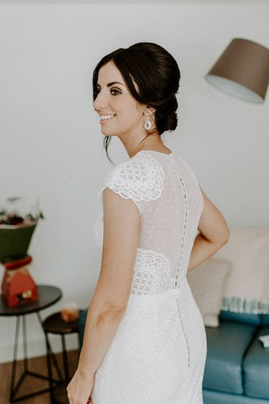 Beautiful Jesus Peiro wedding dress with cap sleeves and statement back
