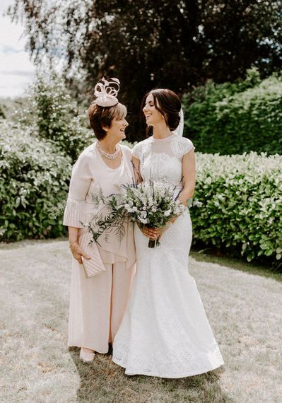 Bride in Jesus Peiro wedding dress with mother of the bride