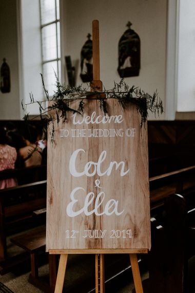 Handmade wooden wedding sign for church ceremony