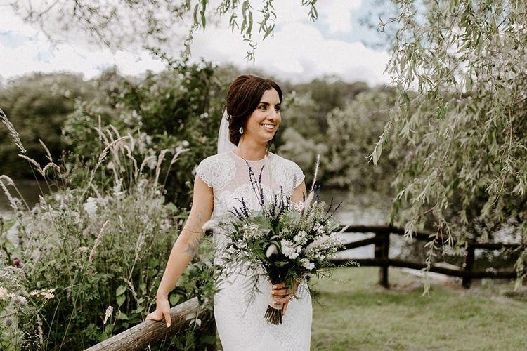 Bridal undo with wild flower bouquet and Jesus Peiro wedding dress