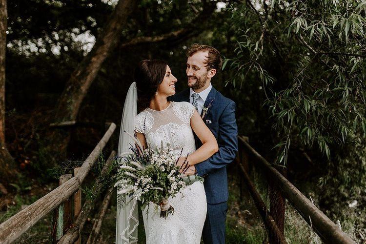 Bride and groom at Irish wedding with Jesus Peiro wedding dress