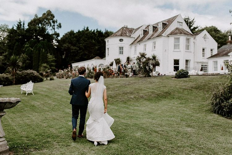 Jesus Peiro wedding dress for bride with groom at Innishannon House