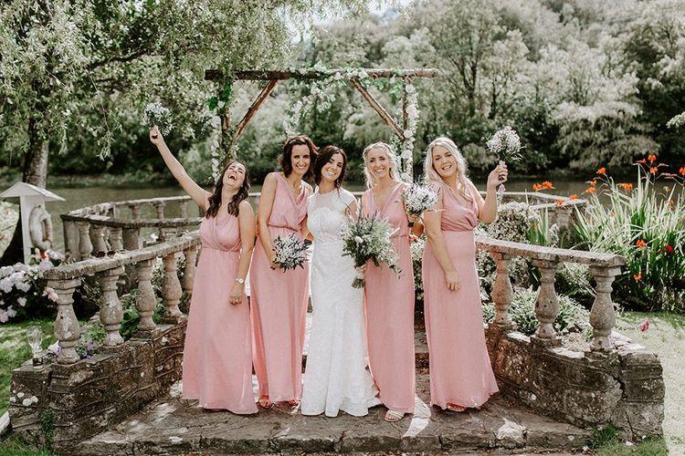 Pink bridesmaid dresses with bride in Jesus Peiro wedding dress