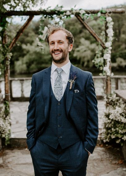 Groom in blue wedding suit