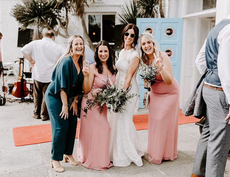Bride in Jesus Peiro wedding dress with wedding guests and bridesmaids