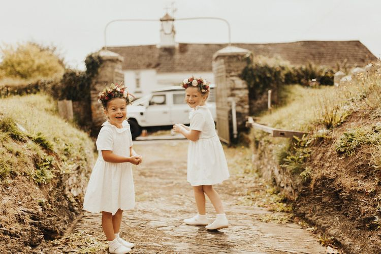 Flower girls in flower crowns and white dresses