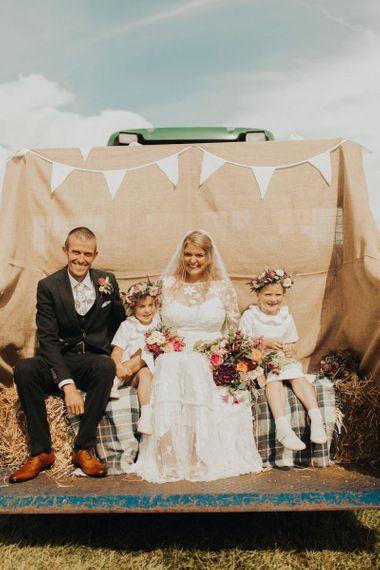 Family portrait with bride in Eliza Jane Howell wedding dress