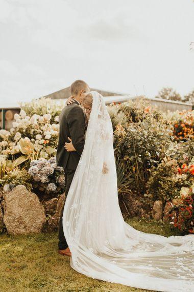 Lace veil for bride in Eliza Jane Howell wedding dress