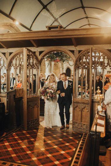 Bride in Eliza Jane Howell wedding dress arriving at church