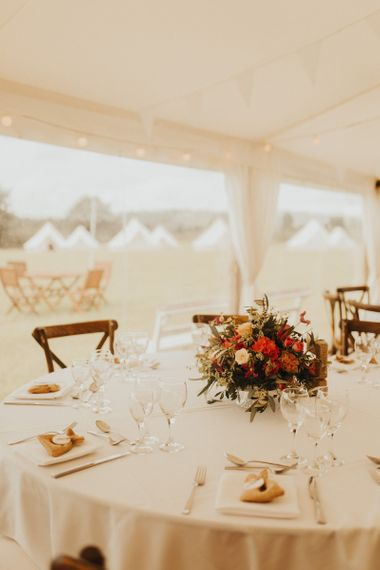 Rust coloured wedding flowers at marquee wedding with bride wearing Eliza Jane Howell wedding dress