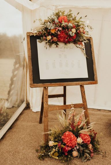 Wedding seating chart with floral decor