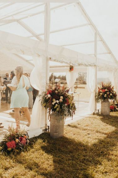 Wedding flowers at marquee entrance