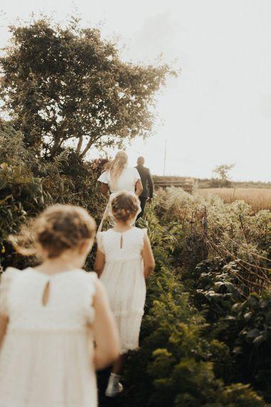 Family walking through Dartmoor Field wedding venue