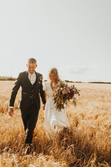 Bride changes from Eliza Jane Howell dress to Ghost wedding dress