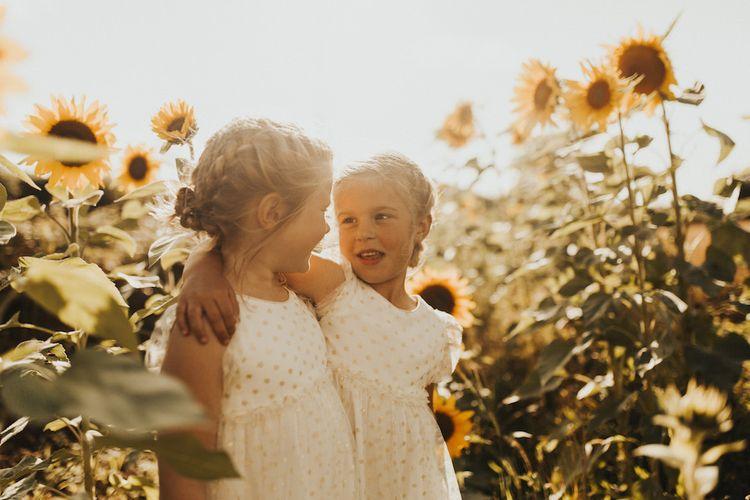 Flower girl portrait in sunflower field
