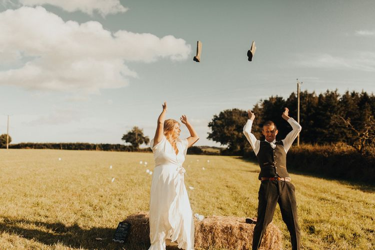 Bride and groom well throwing
