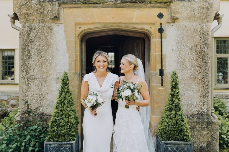 Bridesmaid in Ghost London White Satin Dress with White Wedding Flowers at Family Home