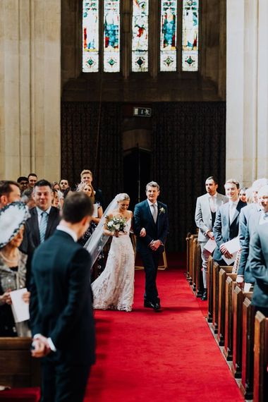 Bride Walking Down the Aisle in Bridal Two Piece