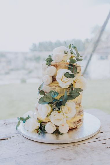 Homemade Semi Naked Rustic Wedding Cake with White Floral Decoration