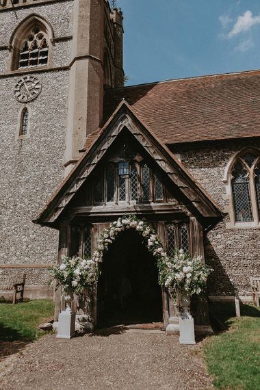 Church Entrance Wedding Flowers with Floral Arch and Arrangements