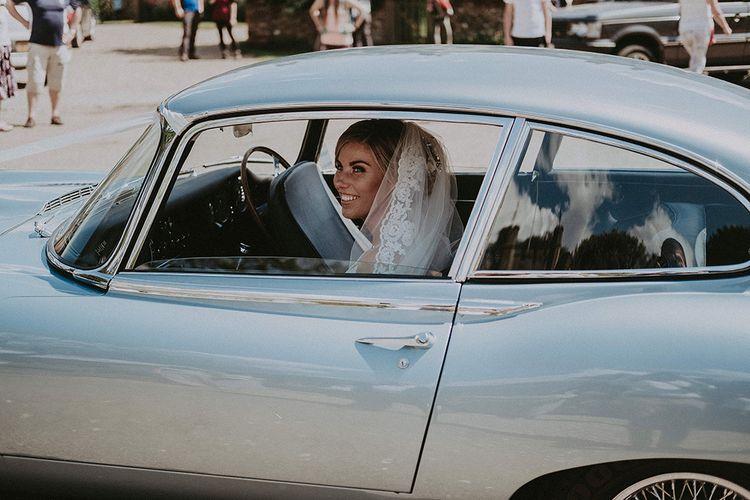 Bride Arriving to the Church in a Blue  E-Type Jaguar Wedding Car