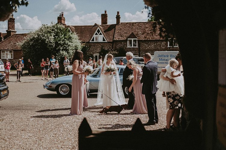 Bridal Partying Arriving at the Church in a Blue  E-Type Jaguar Wedding Car