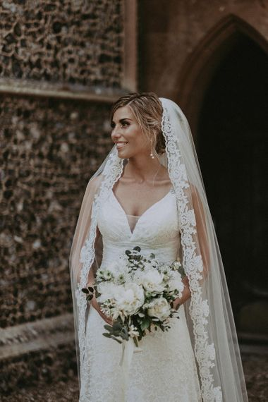 Beautiful Bride in Lace Wedding Dress with Lace Trim Wedding Veil