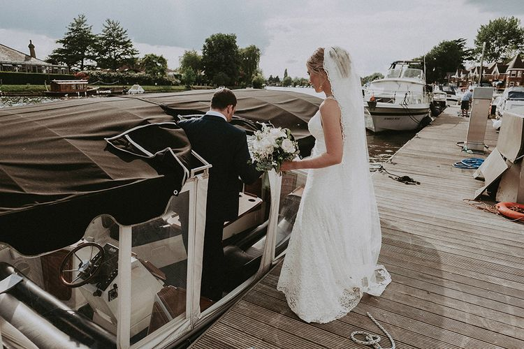 Bride and Groom Getting on a Boat to Cross The River to Their Moat Side Pub Wedding Reception