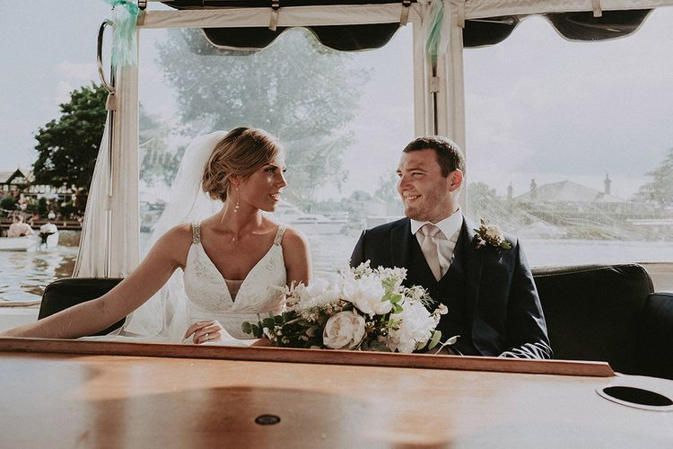 Bride and Groom Enjoying a River Side Cruise