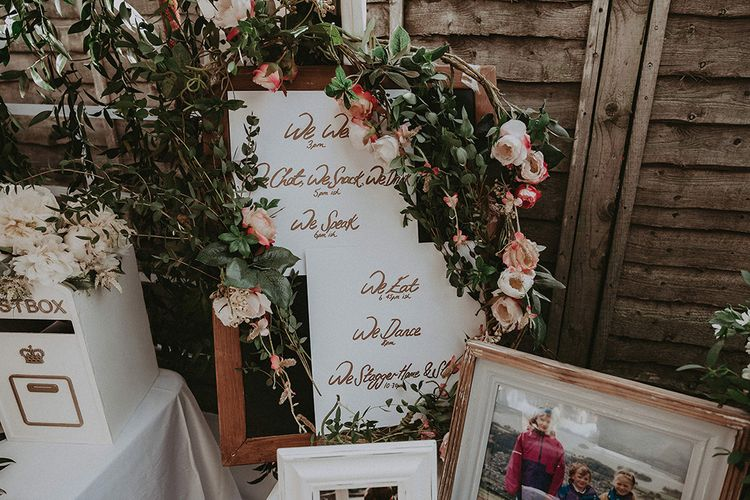 Order of The Day Wedding Sign with Family Portrait and Flower Wedding Decor