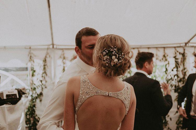 Pinned Back Bridal Up Do with Fresh Flower Decor