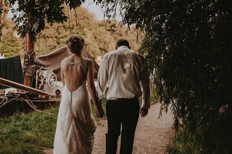 Bride and Groom Walking By The River Bank