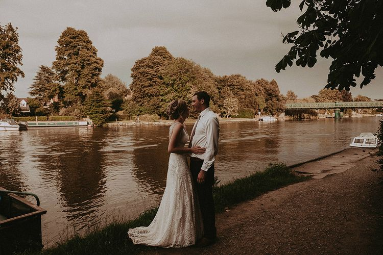 Bride and Groom Portrait By The River Bank
