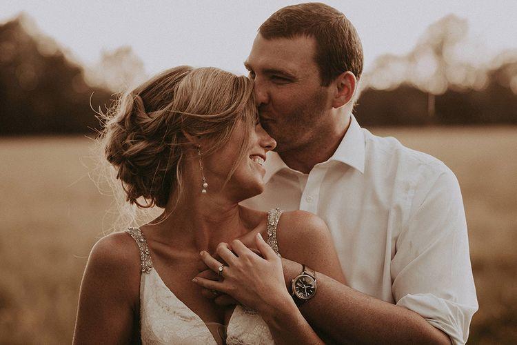 Groom Kissing The Brides Forehead