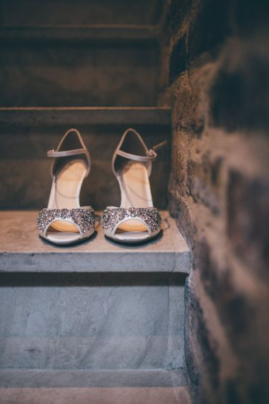 Brides shoes at city celebration with fairy light backdrop