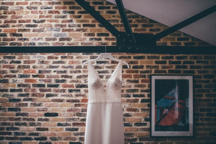 Brides Enzoani dress for summer London wedding with fairy light backdrop