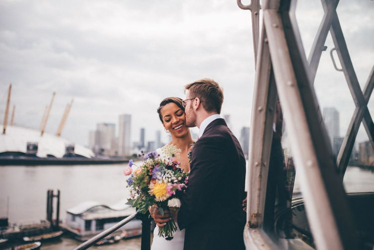 Bride and groom steal a moment at London city celebration with fairy light backdrop